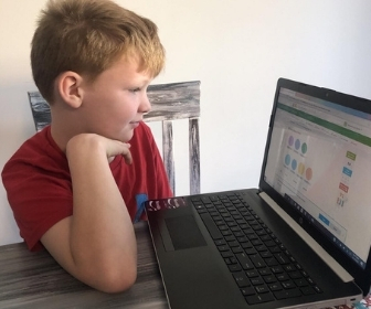 Student doing eLearning at home